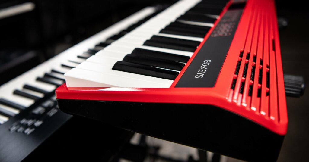 Side view photo of red keyboard - Roland GO:KEYS.
