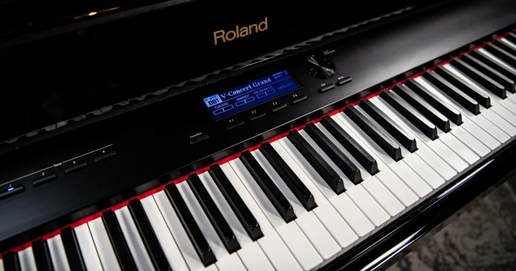 Close up of Roland V-Piano grand keyboard showing controls.