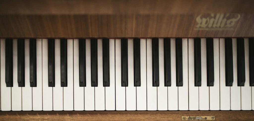 Bird's eye view of piano keyboard of wood finish piano.