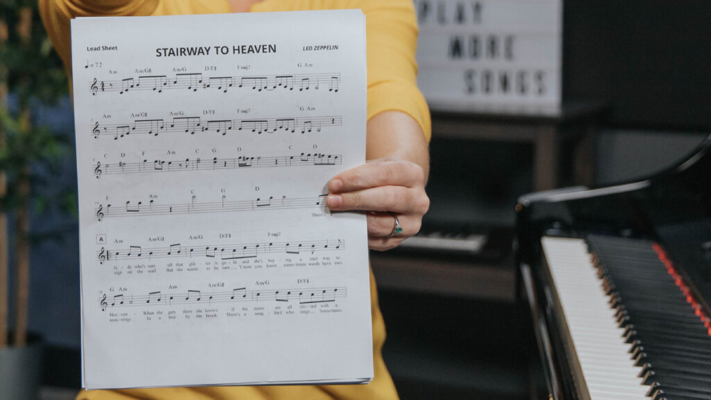 Up close Lisa holding Stairway to Heaven lead sheet.